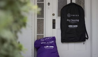 Press laundry and dry cleaning bag on doorstep